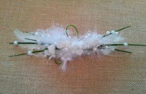 prendido de perlas y flores de hortensia